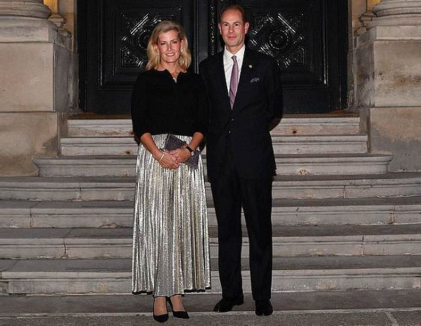 Countess of wessex wore Emilia Wickstead Dalia Python-print blouse and Richie Python-print skirt and carried Sophie Habsburg Amber clutch