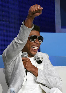 Bryshere Gray wearing white suit and sunglasses