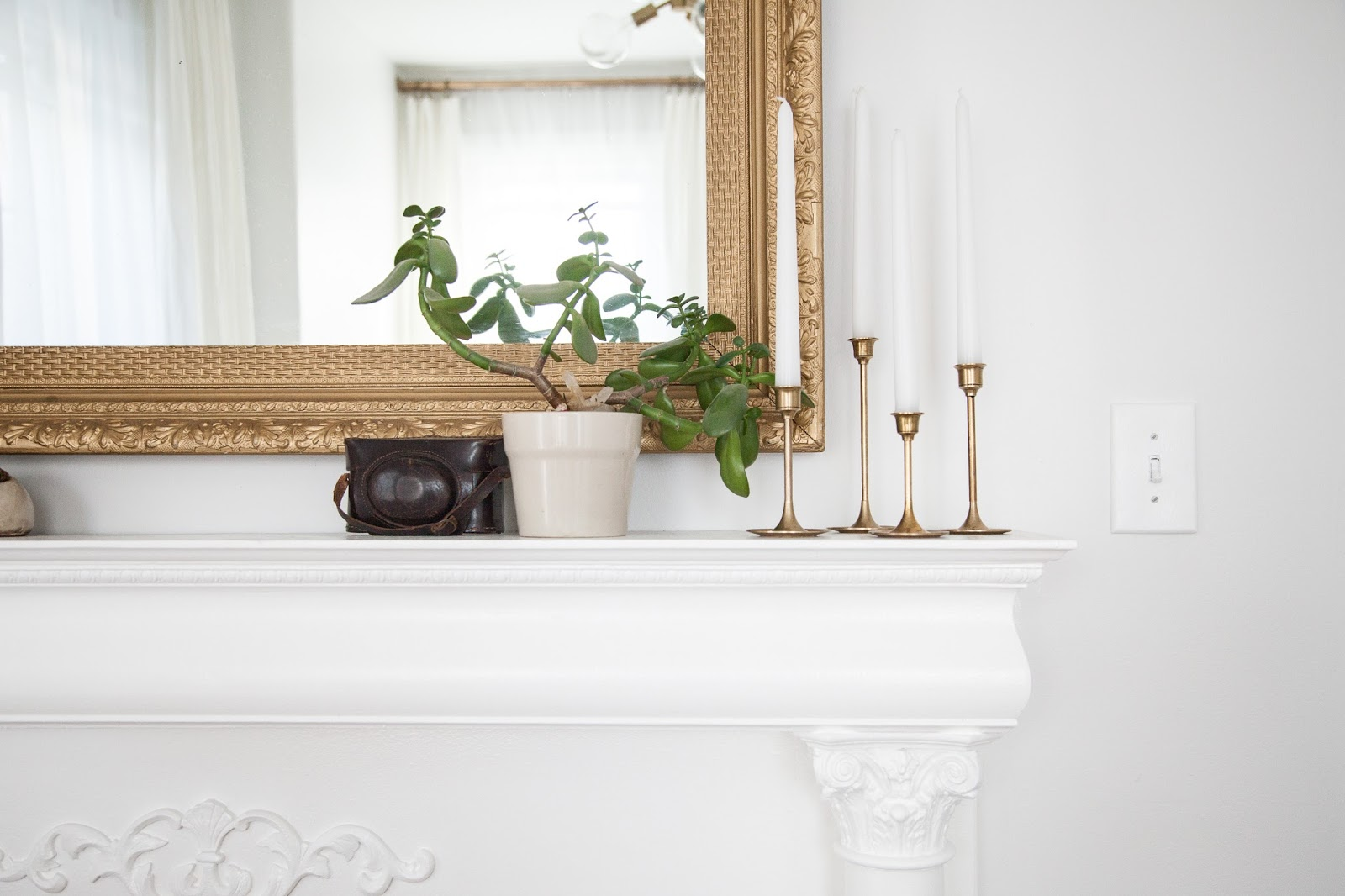 Mantel Decor with Gold Mirror and Brass Candlesticks