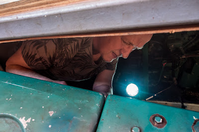 Photo of Phil working on the heat exchanger in the engine room