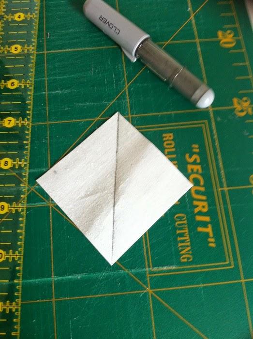 Teken een diagonale lijn op het lichte vierkantje