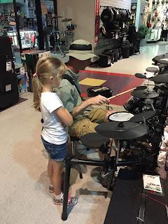 daughter watching dad play drums