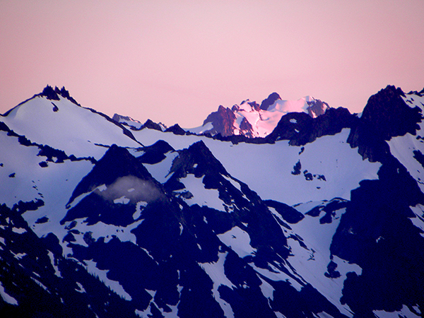 Dark Mountains and Snow with Pink Sunset on Mt. Olympus Blue Glacier