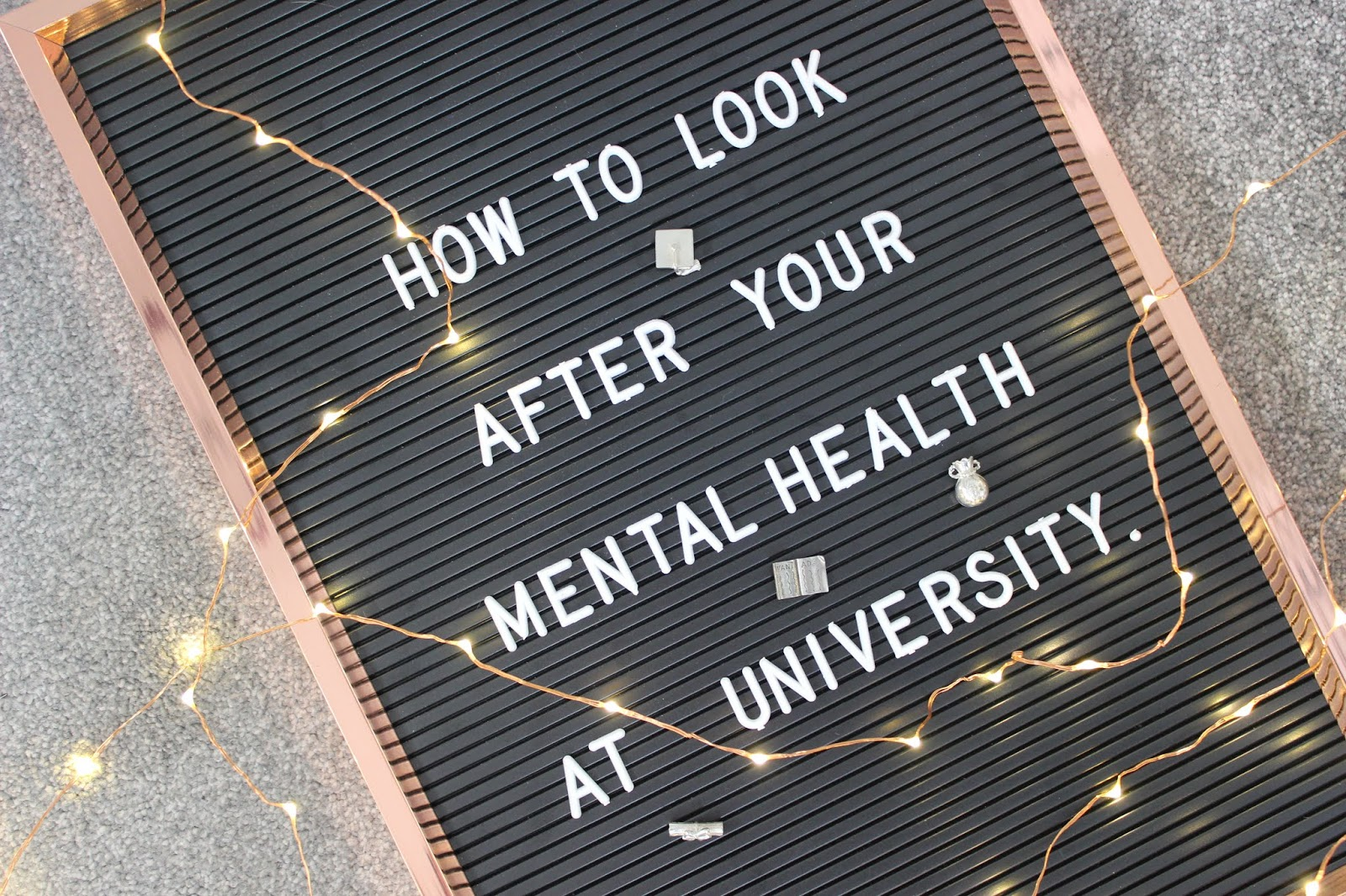 A blackboard with text 'how to look after your mental health at university'