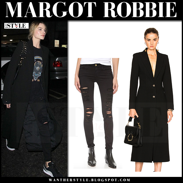 Margot Robbie in black long smythe brando coat and black ripped jeans frame denim what she wore