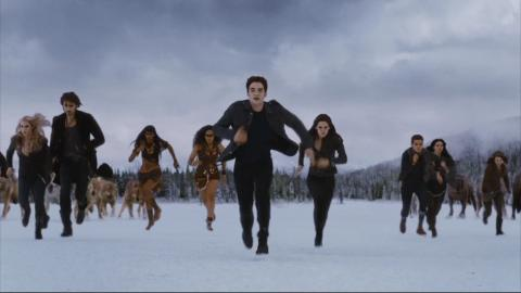 The Twilight Saga: Breaking Dawn Part 2 the Cullens and their allies running in the snow movieloversreviews.filminspector.com