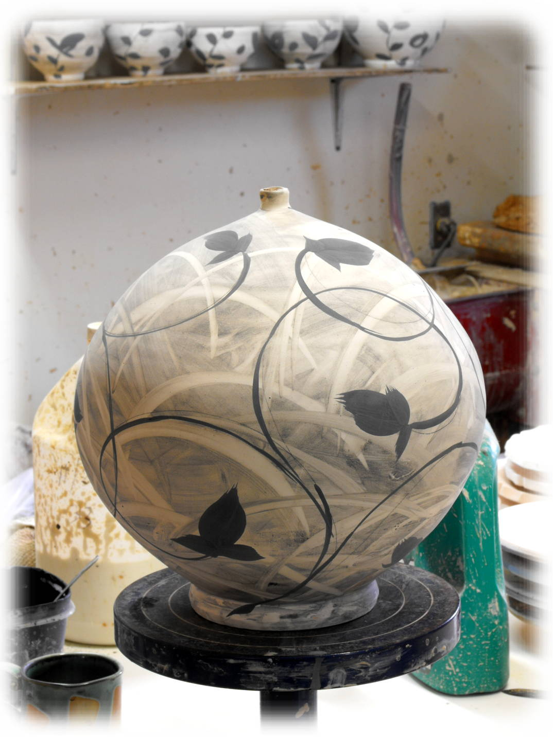 pottery technique round spherical closed form potter's wheel brushwork hand painted