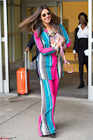 Priyanka Chopra in Colorful Jumpsuit arriving at JFK Airport New York 18 June 2017 ~  Exclusive 015.jpg