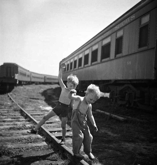 boys-playing-train-tracks