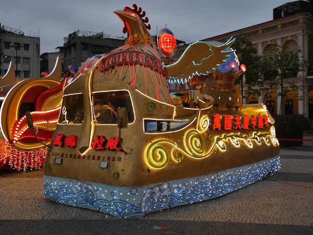 Lunar New Year rooster parade float lit up at night in Macau