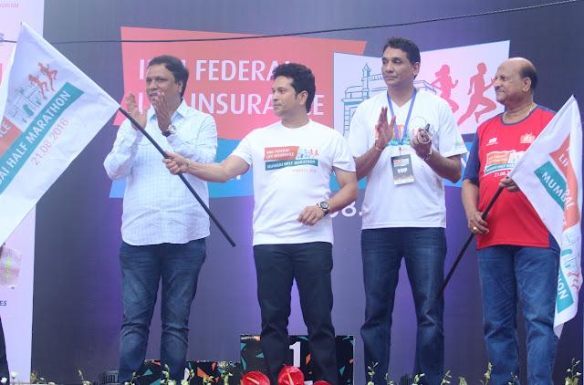 Pic 2: (L-R) Ashish Shelar, MLA & President, Bharatiya Janata Party,Sachin Tendulkar, Face of the Marathon,Vighnesh Shahane, CEO, IDBI Federal Life Insurance and Kishor Kharat, MD & CEO, IDBI Bank flagging off the Inaugural IDBI Federal Life Insurance Mumbai Half Marathon.