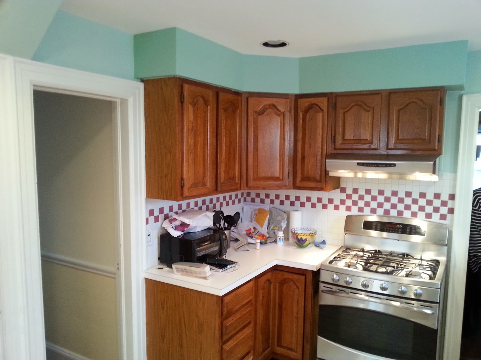 kitchen cabinets refinished refurbished kitchen cabinets The cabinets installed by the previous owner were oak with a dark stain Time had taken its toll The first step was to use a chemical de glosser to remove