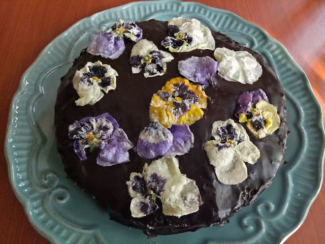 Matcha cake with chocolate frosting and candied pansies