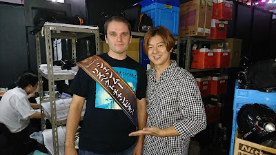 "IGN Japan's Esra Krabbe (wearing his ""Shenmue Respect Champion"" sash) backstage with Matsukaze-san."