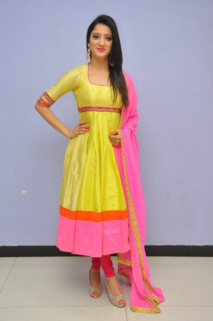 Telugu Cute Girl Richa Panai Photos In Yellow Dress At  Audio Launch