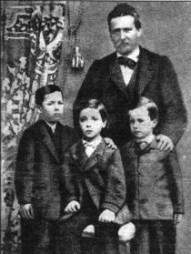 Giovanni Pascoli (right) as a child, pictured with his father and two brothers