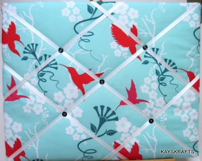 French ribbon memory board with hummingbirds on turquoise background