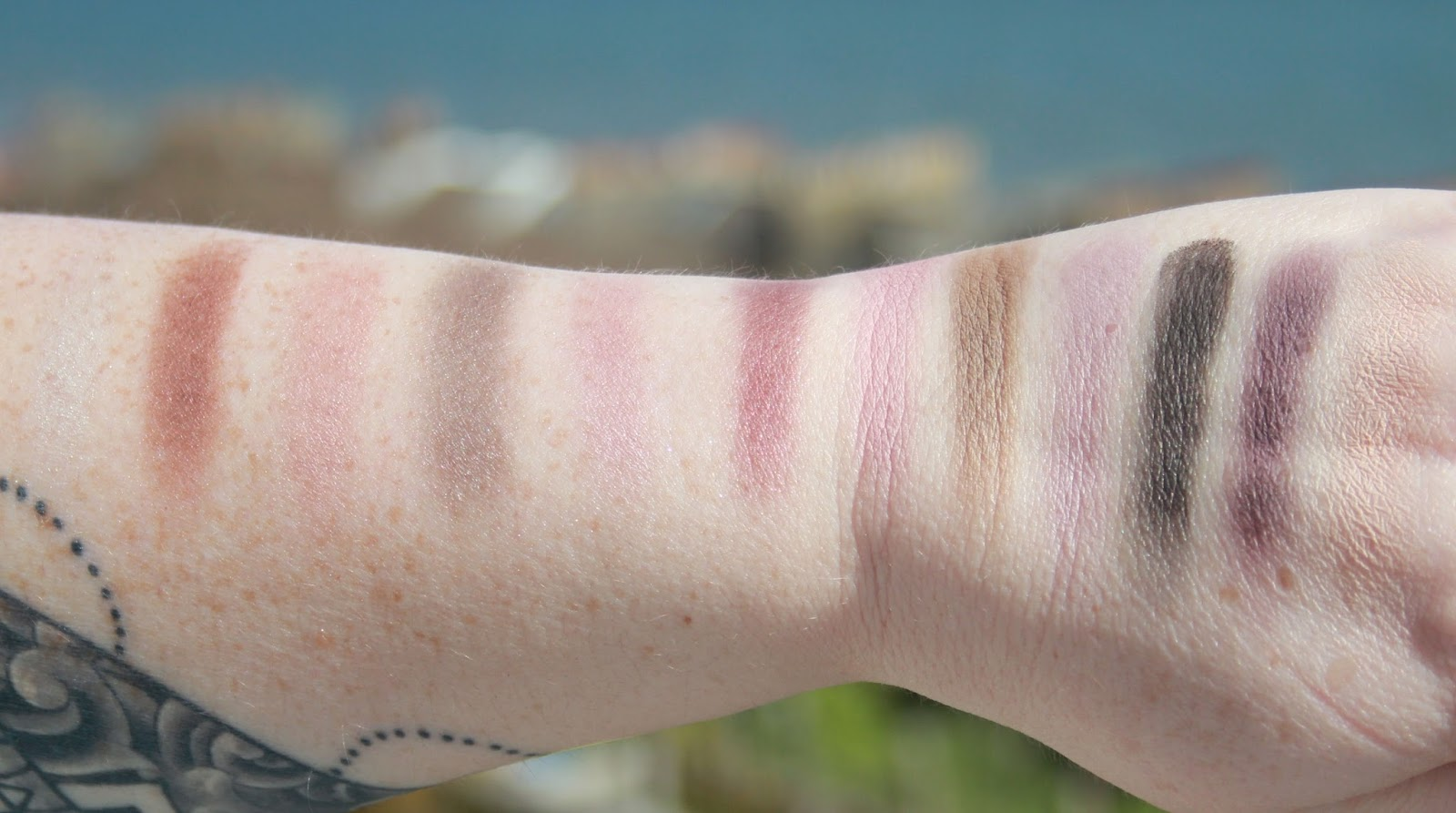 Swatches of the Makeup Revolution Romantic Smoked Palette