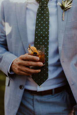 groom holding drink