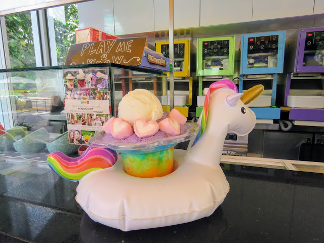 Rainbow snow in an inflatable unicorn cup holder from WooW in Singapore
