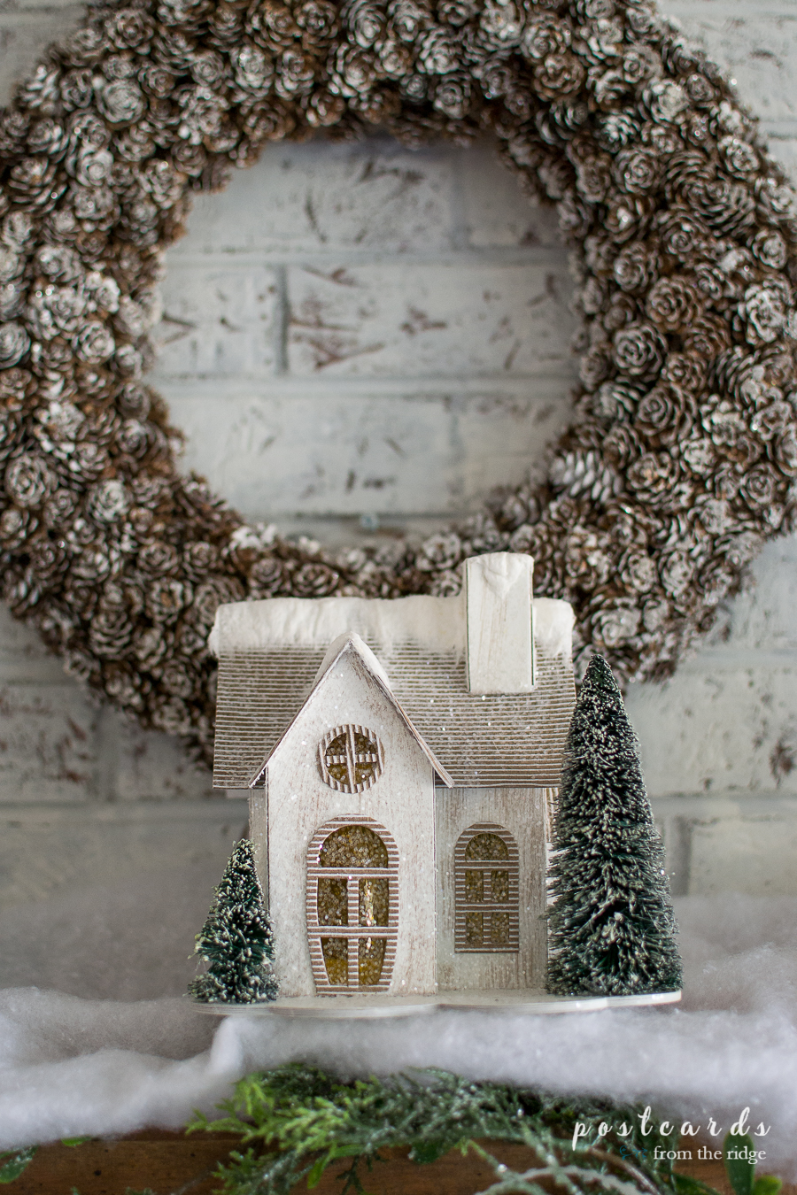 farmhouse style Christmas mantel with snow covered houses