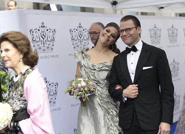 King Carl Gustaf, Queen Silvia, Crown Princess Victoria, Prince Daniel, Princess Madeleine, Prince Carl Philip and Princess Christina, Mrs. Magnuson