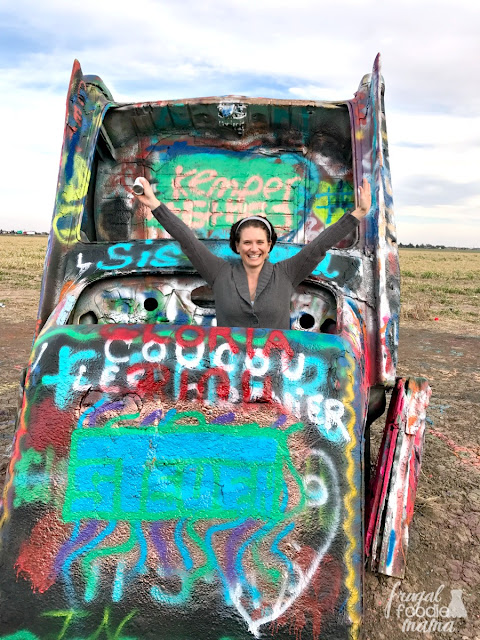 Tourists come from all over the world to leave their mark one spray paint can at a time on one of the ten classic Cadillacs buried nose first into the former wheat field- better known as Cadillac Ranch in Amarillo, Texas.