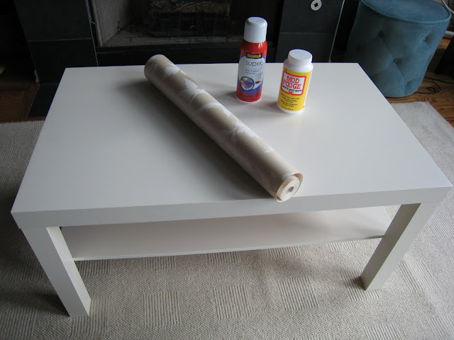 Supplies needed for Ikea Lack makeover with wallpaper and nail head trim