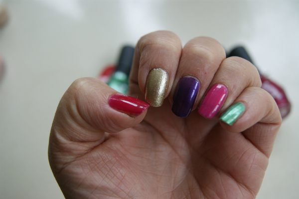 One Direction Nail Polishes Raspberry Rush, Popstar Purple, Everything Emerald, Gold & Gorgeous, Fuschia Frenzy Swatches