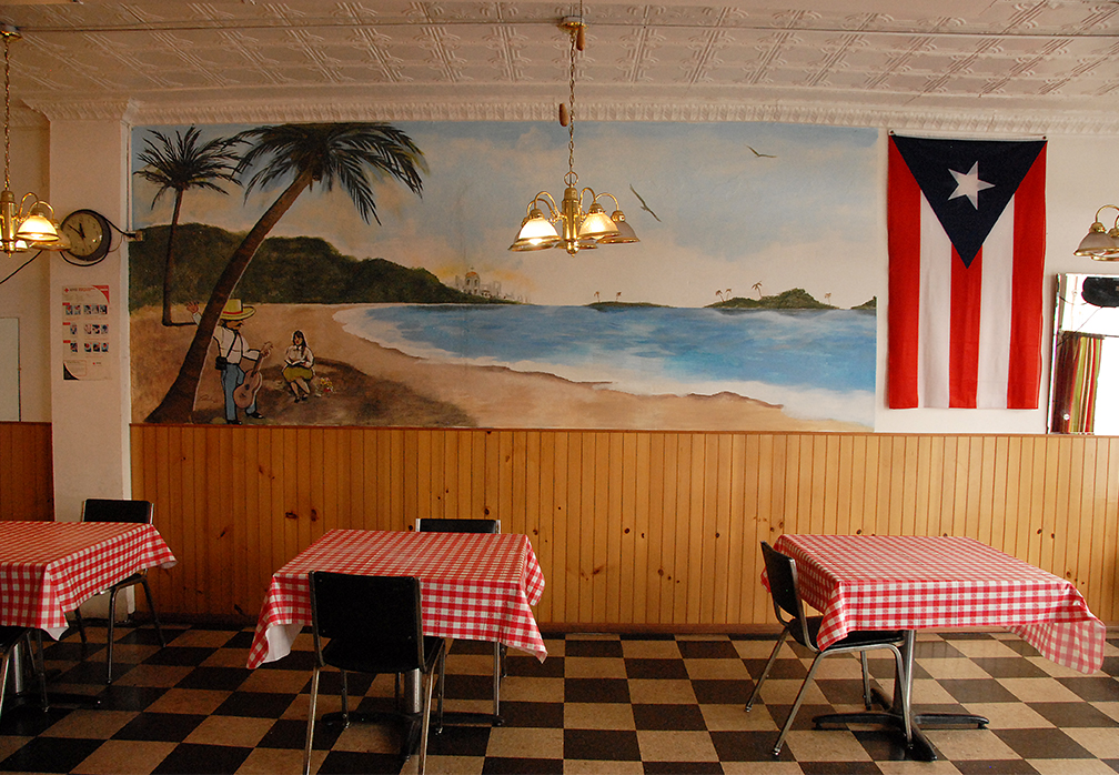 The Interior Is Very Basic With Homeland Décor And A Large Wall Mural There Are Not Many Puerto Ricans In Detroit Most Of Our Business Comes From
