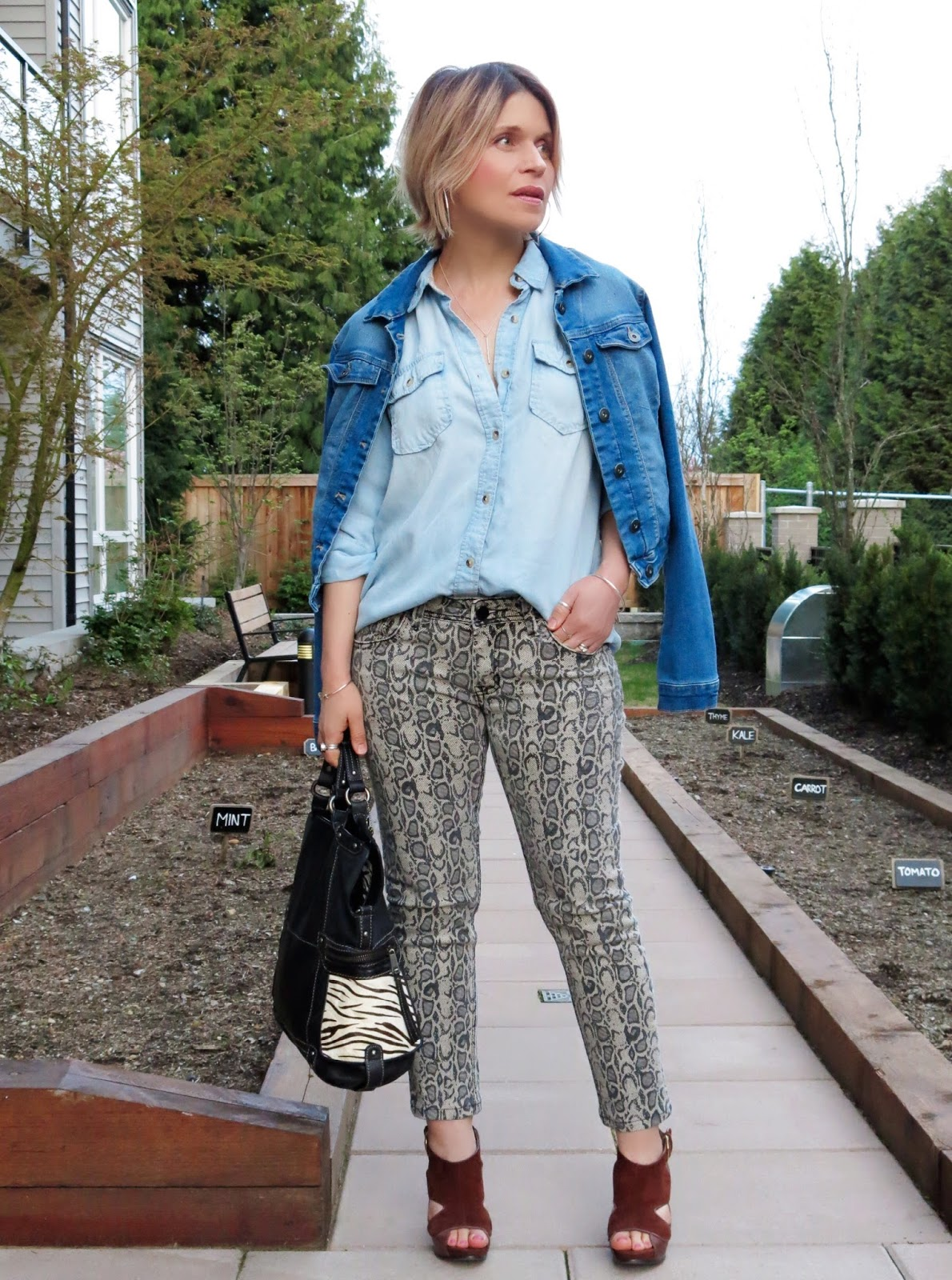 styling snakeskin-patterned jeans with a chambray shirt and denim jacket