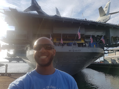 Tim in front of the USS Midway
