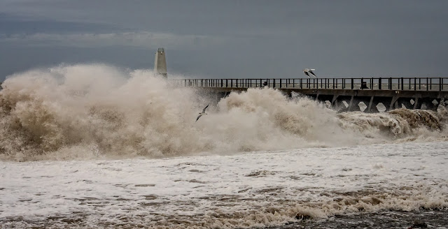 Photo of giant waves whipped up by the high winds on Maryport shore on Tuesday