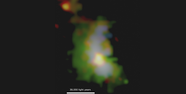 Image of the quasar host galaxy from the UC San Diego research team's data. The distance to this quasar galaxy is ~9.3 billion light years. The four-color image shows findings from use of the Keck Observatory and ALMA. As seen from Keck Observatory, the green colors highlight the energetic gas across the galaxy that is being illuminated by the quasar. The blue color represents powerful winds blowing throughout the galaxy. The red-orange colors represent the cold molecular gas in the system as seen from ALMA. The supermassive black hole sits at the center of the bright red-orange circular area slightly below the middle of the image. CREDIT: A. VAYNER AND TEAM