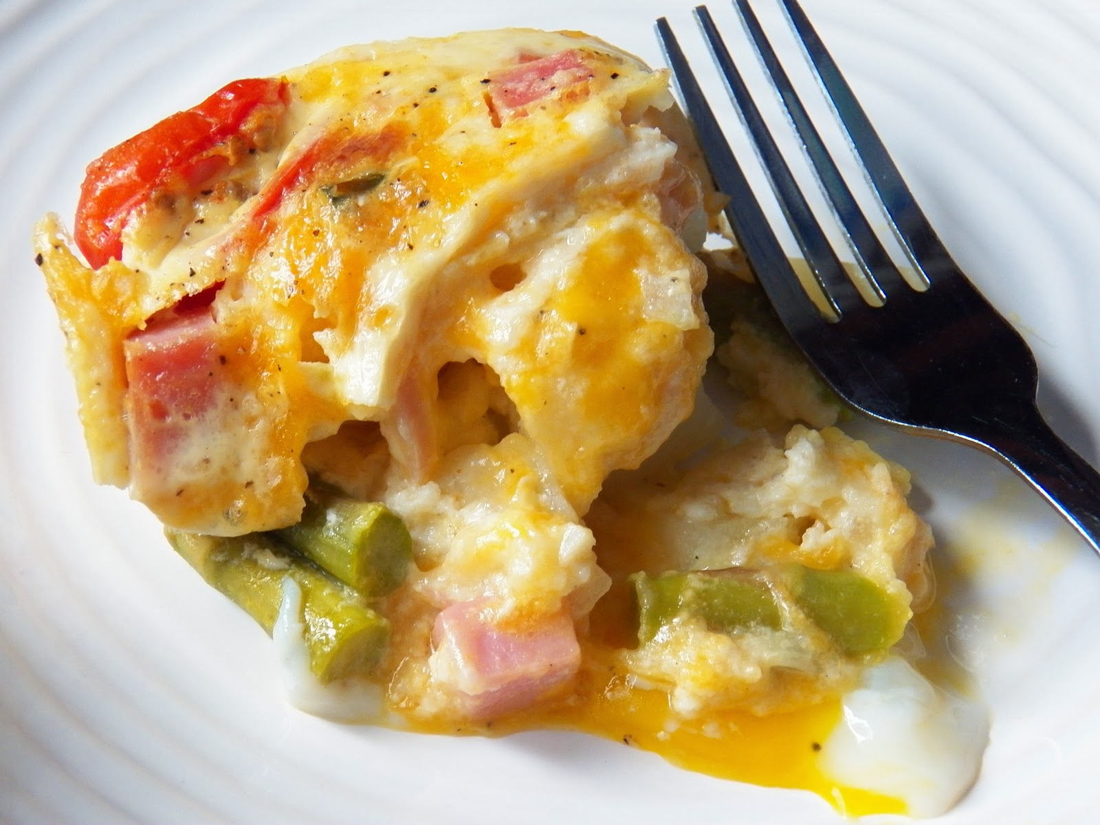 Egg Ham and Asparagus Breakfast Bake,a serving on a white plate