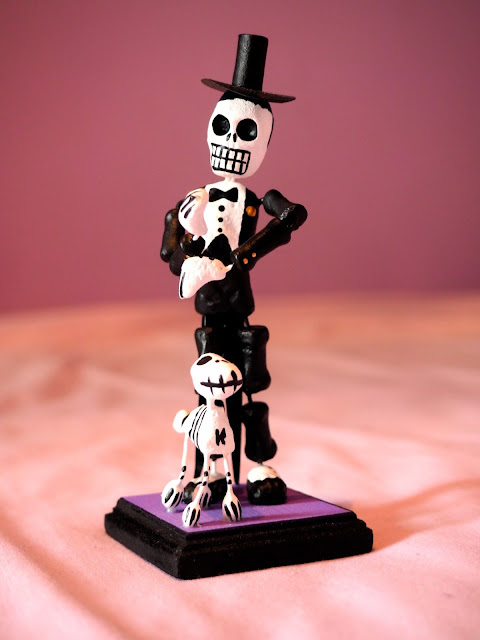 Model of a skeleton in suit & top hat, with dog, from Mexico