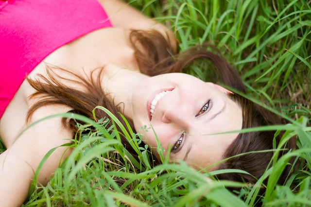 Woman laying in grass after Steaming Face