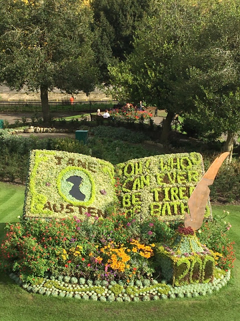 flowers planted to spell out a quote from Jane Austen