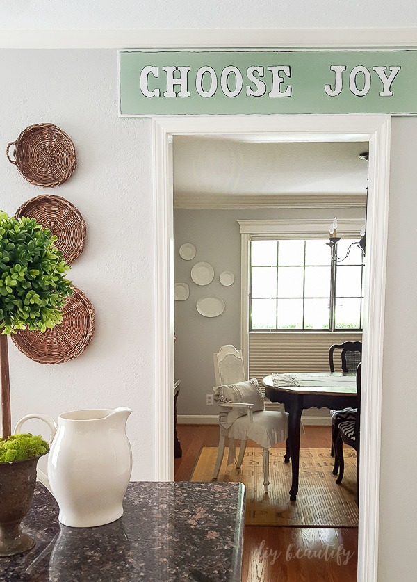 choose joy handmade sign and view of dining room