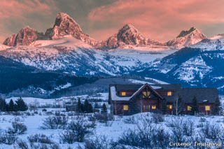 Cramer Imaging's professional quality landscape photograph of the Teton mountains and a cabin at sunset during winter