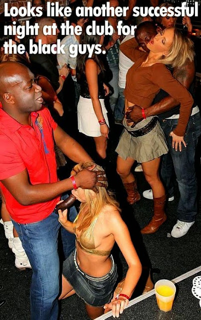 A white woman and a black man are dancing