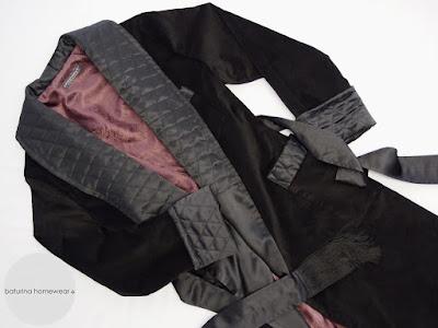 Gentleman's tasselled black quilted velvet and silk smoking robe, fully lined.