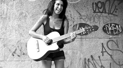 A Still from Asif Kapadia's Amy, playing Guitar