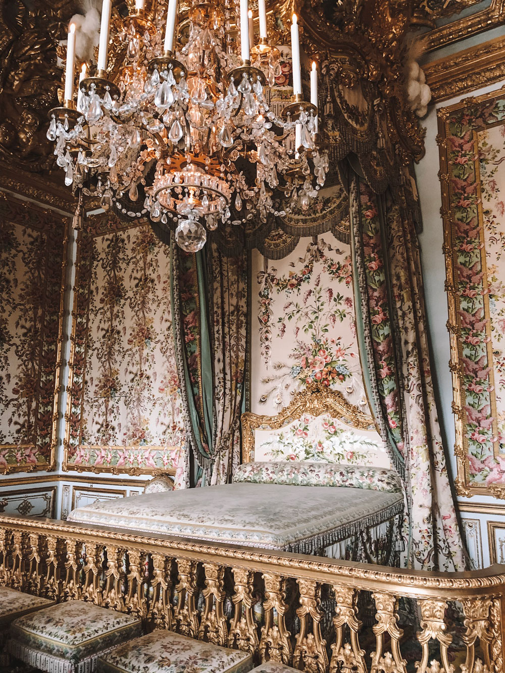 a bedroom fit for a queen at the Palace of Versailles