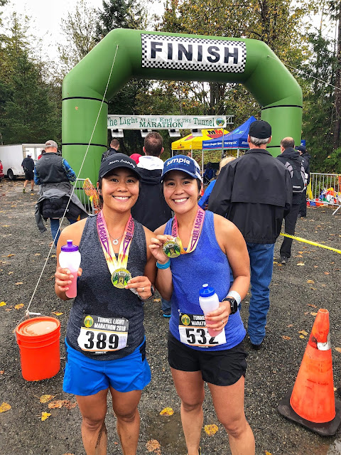 Finish line pic with my sis and Simple Hydration bottles
