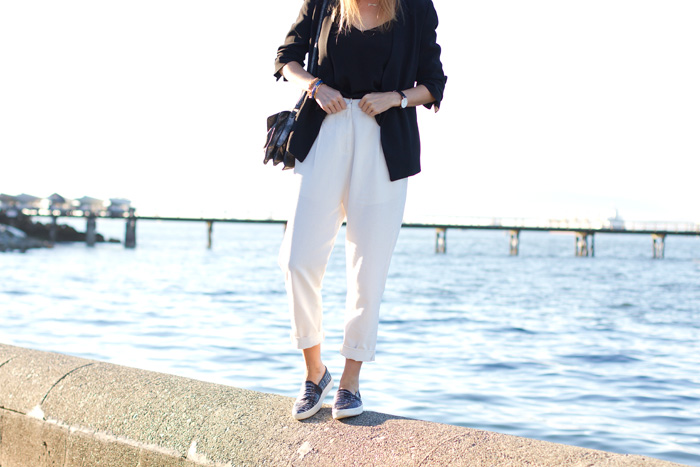 Vancouver Fashion Blogger, Alison Hutchinson, is wearing Front Row Shop white linen trousers, Zara black blazer, Aritzia black silk camisole, Vince slide-ons, Botkier silver bag