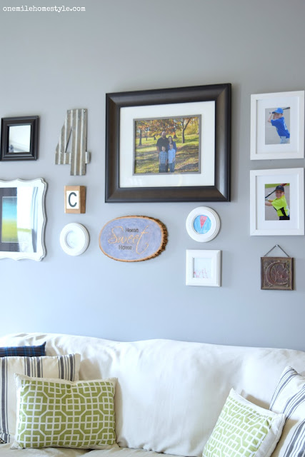 Gallery wall with DIY wood stained home sweet home sign - One Mile Home Style
