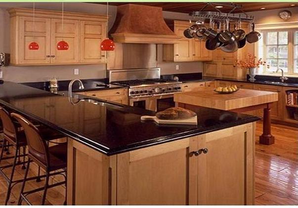 Encimeras de granito y muebles de madera para la - Cocinas con encimeras de madera ...