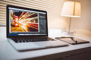 A graphic designer needs laptop for graphic design to optimize their work.