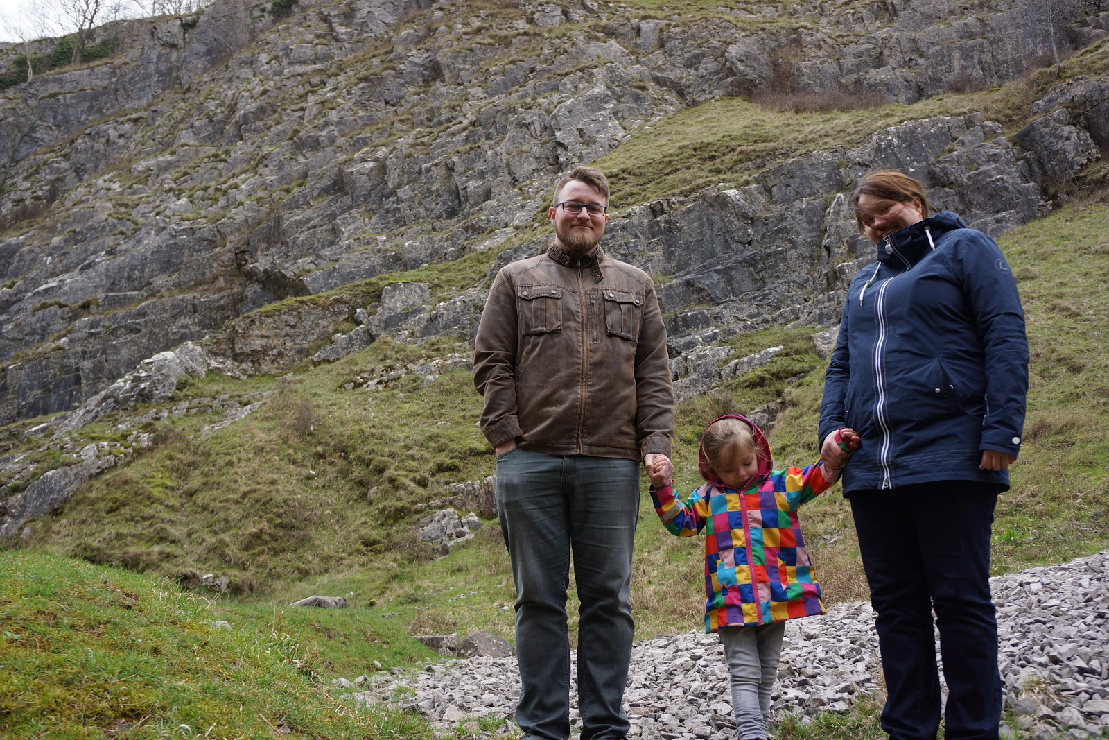mum, dad and daughter at cheddar gorge are of outstanding natural beauty